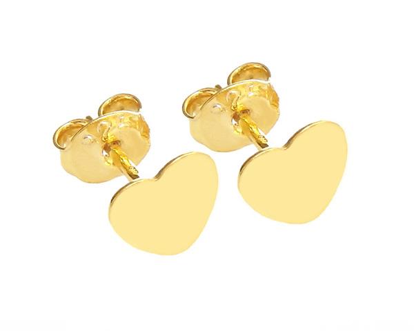 Minimalistyczne kolczyki w kształcie ażurowych serduszek to must have na Walentynki.