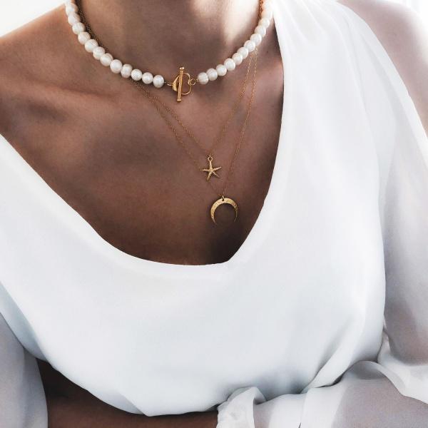 naszyjnik z pereł z zapięciem z przodu w kształcie serca