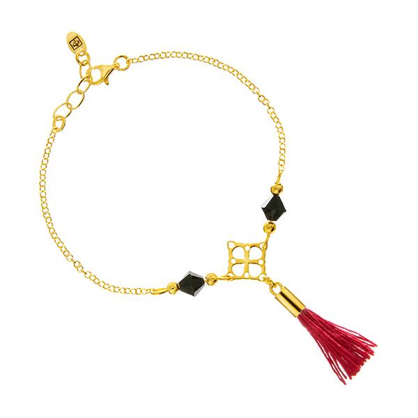 Złota bransoletka z czerwonym chwostem i kryształami swarovski bicone jet.